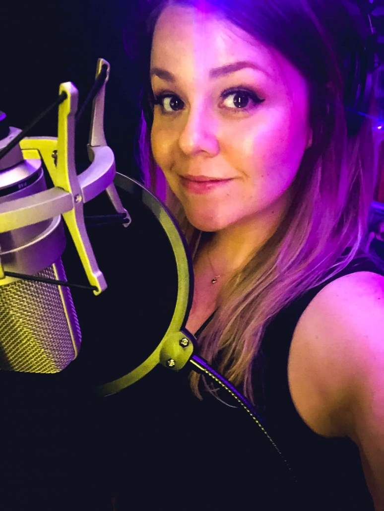 Bonnie in her broadcast quality recording studio with her TLM 103